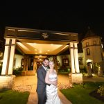 Bride and groom standing in front of St. Georges Golf & Country Club Wedding at night.