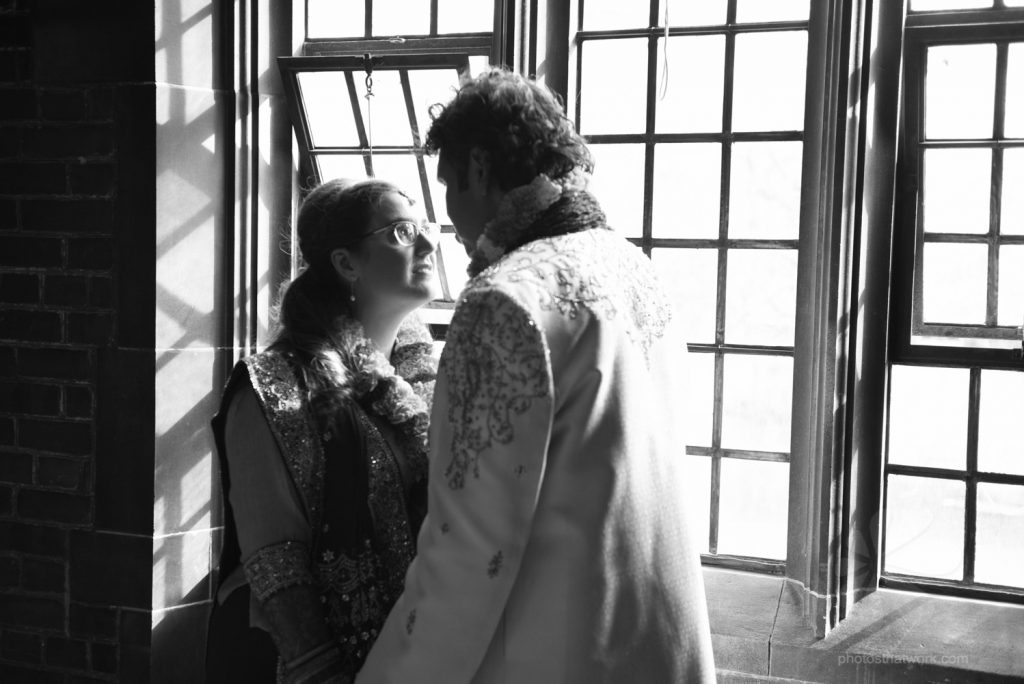 Bridal portrait by the window in the library at the Hart House in Toronto