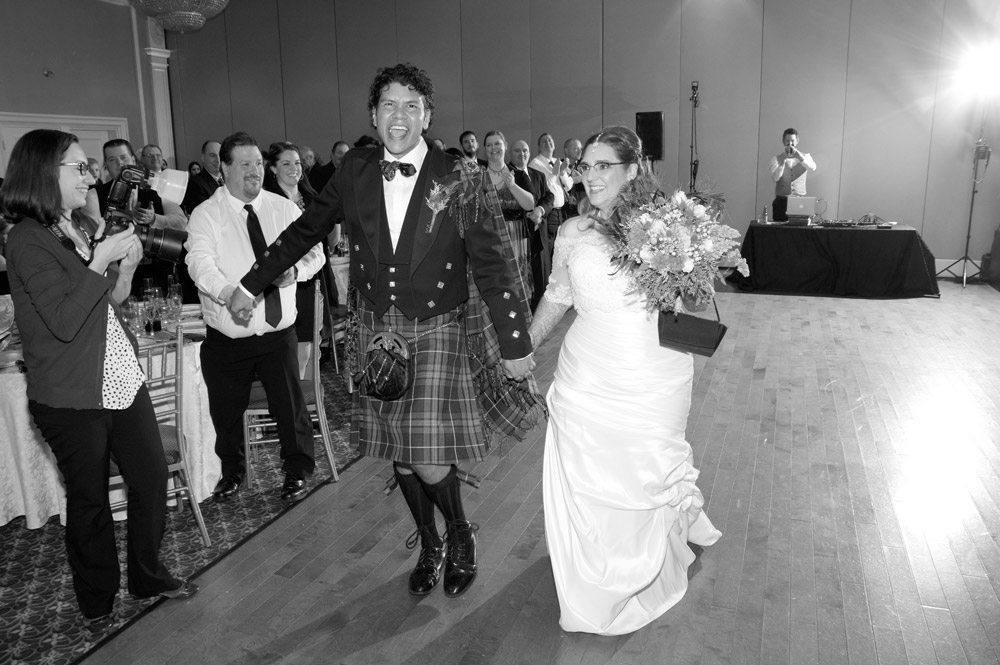 Bride and groom walking into reception at The Jewel Event Centre in Woodbridge.