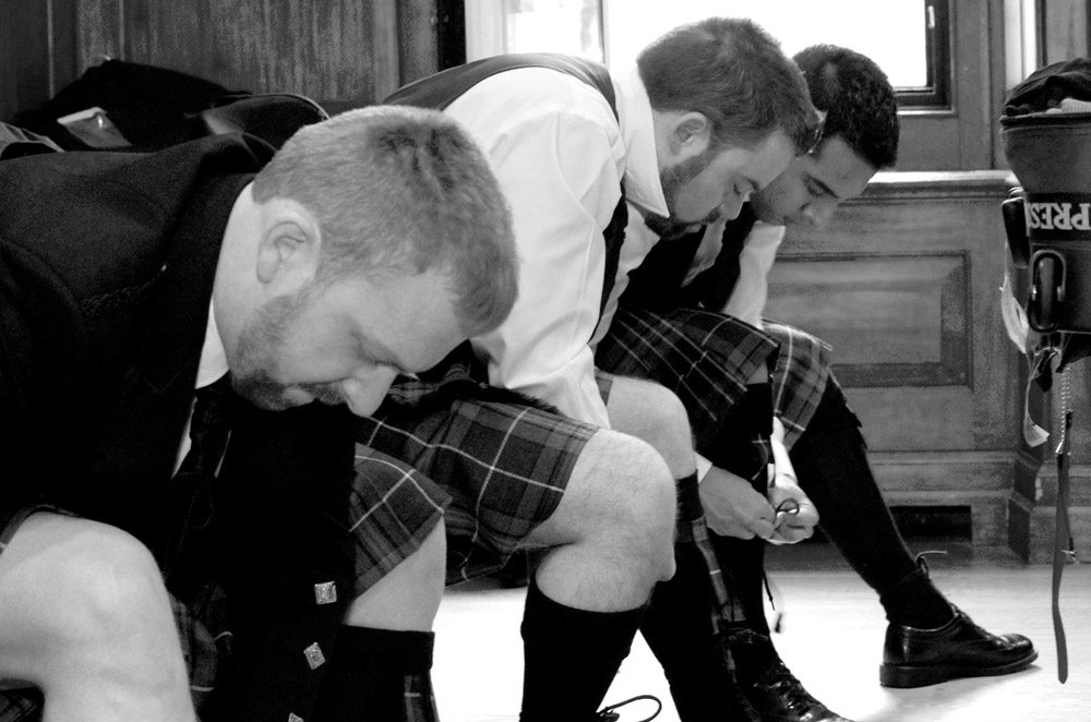 Groom and best men getting dressed at Hart House in Toronto