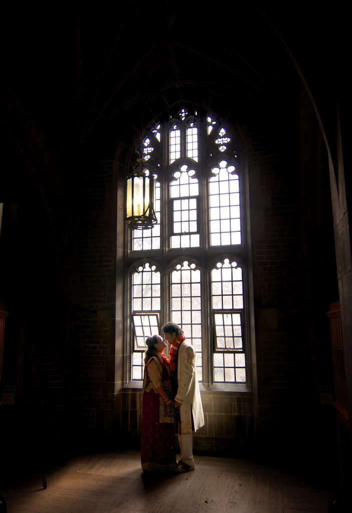 By the window. Bride and groom portraits at the Hart House in Toronto