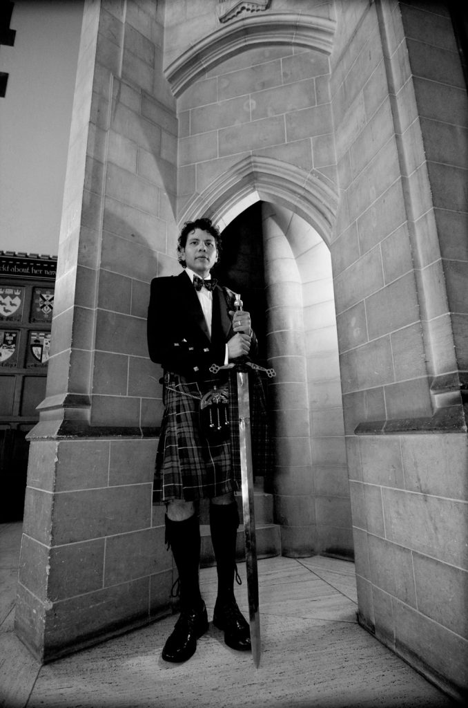 Groom in Scottish kilt and sword at Hart House in Toronto