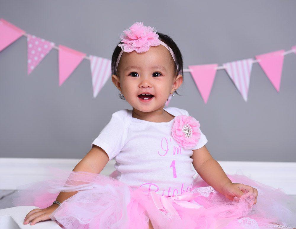 smiling baby in pink tutu