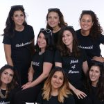 group photo of bachelorette party wearing custom made tshirts of wedding roles