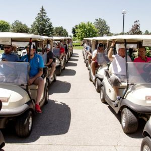 rows of filled golf carts lined up in the sun