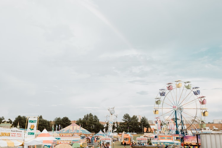 pop up fair with ferris wheel and tents